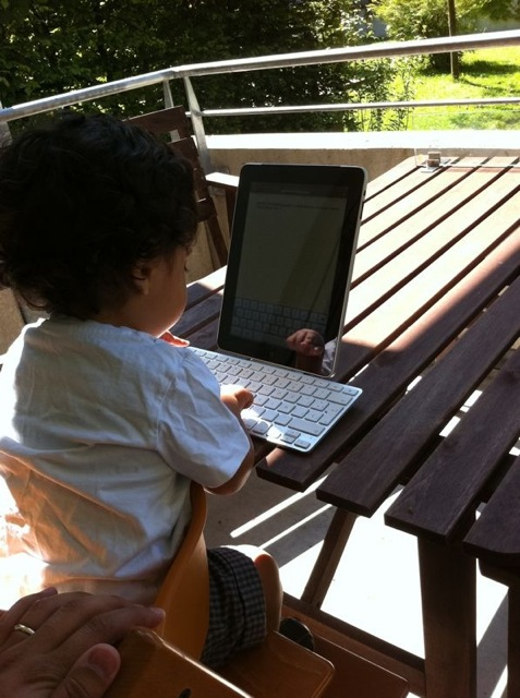 "My son ""working"" with my iPad."